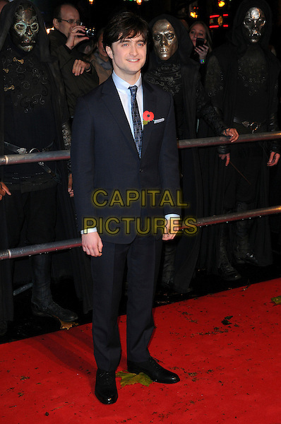 "DANIEL RADCLIFFE .""Harry Potter And The Deathly Hallows: Part 1"" World Film Premiere, Empire cinema Leicester Square and Odeon Leicester Square, London, England, UK, 11th November 2010. .full length black blue navy suit tie poppy shirt  .CAP/CAS.©Bob Cass/Capital Pictures."