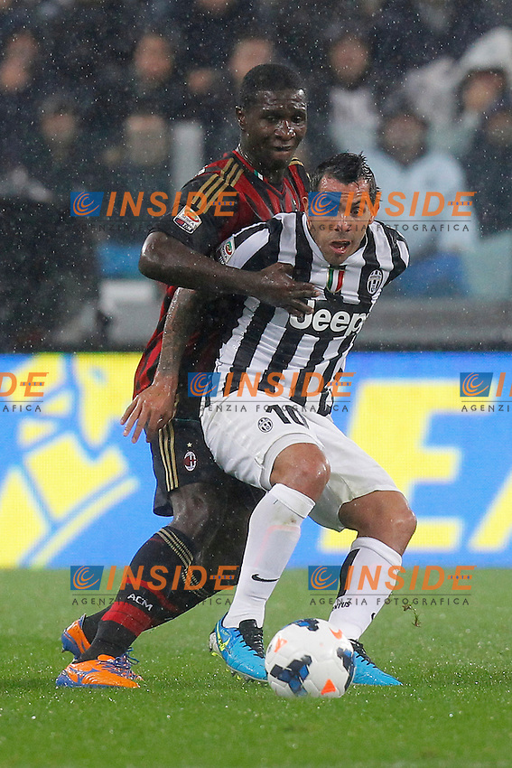 Carlos Tevez Juventus, Cristian Zapata Milan,<br /> Torino 06-10-2013<br /> Juventus Stadium <br /> Football Calcio 2013/2014 Serie A <br /> Juventus - Milan<br /> Foto Marco Bertorello Insidefoto