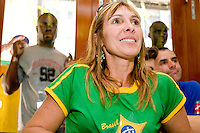 Brazil fan Tania Machado, as well as a crowd outside, watches their team in a match against Australia on June 18, 2006 at the Emporium, a restaurant in a section of New York City known as &quot;Little Brazil&quot;.<br /> <br /> The World Cup, held every four years in different locales, is the world's pre-eminent sports tournament in the world's most popular sport, soccer (or football, as most of the world calls it).  Qualification for the World Cup is open to any country with a national team accredited by FIFA, world soccer's governing body. The first World Cup, organized by FIFA in response to the popularity of the first Olympic Games' soccer tournaments, was held in 1930 in Uruguay and was participated in by 13 nations.    <br /> <br /> As of 2010 there are 208 such teams.  The final field of the World Cup is narrowed down to 32 national teams in the three years preceding the tournament, with each region of the world allotted a specific number of spots.  <br /> <br /> The World Cup is the most widely regularly watched event in the world, with soccer teams being a source of national pride.  In most nations, the whole country is at a standstill when their team is playing in the tournament, everyone's eyes glued to their televisions or their ears to the radio, to see if their team will prevail.  While the United States in general is a conspicuous exception to the grip of World Cup fever there is one city that is a rather large exception to that rule.  In New York City, the most diverse city in a nation of immigrants, the melting pot that is America is on full display as fans of all nations gather in all possible venues to watch their teams and celebrate where they have come from.