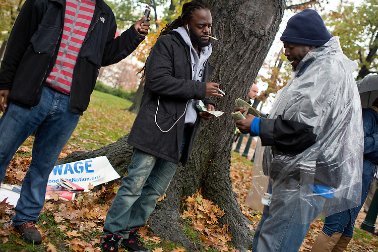 UNITED STATES - NOVEMBER 10: On the day of a Republican presidential debate, a man sells cigarettes during a rally with Sen. Bernie Sanders, I-Vt., in Upper Senate Park with striking workers to call for a minimum wage of $15 per hour, November 10, 2015. Many of the low-wage workers hold jobs on Capitol Hill. (Photo By Tom Williams/CQ Roll Call)