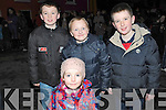CHRISTMAS LIGHTS: Conor Twomey, Joseph Healy, Darragh O'Brien and Sebhirin Ni Thuama, having fun at the switching on of the Christmas Lights in Kilgarvan on Friday evening.