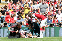 Arsenal's Per Mertesacker receives treatment in the first half after suffering a nasty cut to his face during Arsenal vs Chelsea, FA Community Shield Football at Wembley Stadium on 6th August 2017