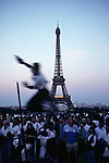 Young Man Skateboard Jumping Near The Eiffell Tower