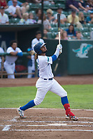 Ogden Raptors shortstop Ronny Brito (5) follows through on his swing during a Pioneer League game against the Great Falls Voyagers at Lindquist Field on August 23, 2018 in Ogden, Utah. The Ogden Raptors defeated the Great Falls Voyagers by a score of 8-7. (Zachary Lucy/Four Seam Images)