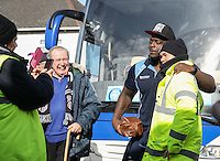 Grimsby Town Safety Stewards take it in turns to stop Adebayo Akinfenwa of Wycombe Wanderers for photos as he arrives for the Sky Bet League 2 match between Grimsby Town and Wycombe Wanderers at Blundell Park, Cleethorpes, England on 4 March 2017. Photo by Andy Rowland / PRiME Media Images.