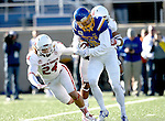 BROOKINGS, SD - NOVEMBER 12:  Jake Wieneke #19 from South Dakota State University tries to escape the defense of Jacob Warner #24 and Adam Harris #7 from the University of South Dakota in the first half at the Dana J. Dykhouse Stadium November 12, 2016 in Brookings, South Dakota. (Photo by Dave Eggen/Inertia)