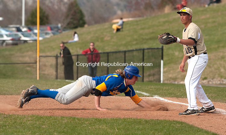 BEACON FALLS, CT-0425014JS04-Seymour's Zach Sirowich (42) dives back to first as Woodland's Dylan Cummings (18) waits for the ball during their game Friday at Woodland Regional High School. <br /> Jim Shannon Republican-American