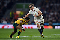 Joe Launchbury of England takes on the Australia defence. Rugby World Cup Pool A match between England and Australia on October 3, 2015 at Twickenham Stadium in London, England. Photo by: Patrick Khachfe / Onside Images