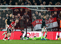 24th November 2019; Bramall Lane, Sheffield, Yorkshire, England; English Premier League Football, Sheffield United versus Manchester United; Oliver McBurnie of Sheffield United runs to celebrate as he scores in the 90th minute to make it 3-3 beating David De Gea of Manchester United with Harry Maguire of Manchester United and Brandon Williams of Manchester United close by - Strictly Editorial Use Only. No use with unauthorized audio, video, data, fixture lists, club/league logos or 'live' services. Online in-match use limited to 120 images, no video emulation. No use in betting, games or single club/league/player publications