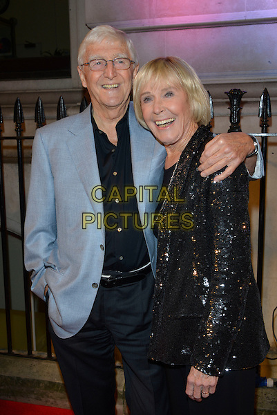 Sir Michael Parkinson &amp; Mary Parkinson<br /> BFI's 'Luminous' gala diner and auction, 8 Northumberland Avenue, London, England.<br /> 8th October 2013<br /> half length black blue suit jacket blazer sequins sequined married husband wife <br /> CAP/PL<br /> &copy;Phil Loftus/Capital Pictures