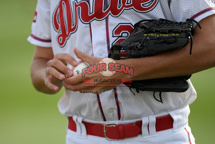 Starting pitcher Hunter Haworth (20) of the Greenville Drive rubs up a baseball before a game against the Hickory Crawdads on Wednesday, May 15, 2019, at Fluor Field at the West End in Greenville, South Carolina. Greenville won, 6-5. (Tom Priddy/Four Seam Images)
