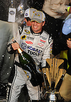 Nov. 16, 2008; Homestead, FL, USA; NASCAR Sprint Cup Series driver Jimmie Johnson sprays champagne after winning the 2008 championship following the Ford 400 at Homestead Miami Speedway. Mandatory Credit: Mark J. Rebilas-