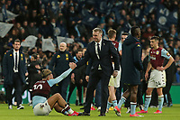 A dejected Jack Grealish of Aston Villa is lifted by Aston Villa's Head Coach Dean Smith.  Aston Villa vs Manchester City, Caraboa Cup Final Football at Wembley Stadium on 1st March 2020