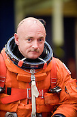 NASA astronaut Mark Kelly, STS-134 commander, attired in a training version of his shuttle launch and entry suit, awaits the start of a training session in the crew compartment trainer (CCT-2) in the Space Vehicle Mockup Facility at NASA's Johnson Space Center on February 11, 2010.  Kelly is the husband of United States Representative Gabrielle Giffords (Democrat of Arizona), who was shot in Arizona on Saturday, January 8, 2011..Mandatory Credit: James Blair / NASA via CNP