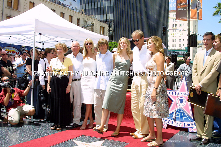 ©2003 KATHY HUTCHINS / HUTCHINS PHOTO.HOLLYWOOD WALK OF FAME.KEVIN COSTNER STAR.AUGUST 11, 2003.HOLLYWOOD, CA..KEVIN COSTNER AND FAMILY
