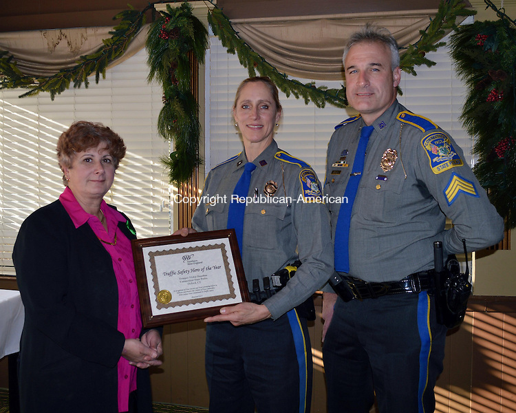 OXFORD, CT - 26 December 2013 - 122613QL02 - Frances B. Mayko, left, public affairs manager of AAA Southern New England, presents an award to Oxford Resident Trooper Vicki Donohoe as an AAA Traffic Safety Hero for her efforts to aggressively pursue distracted driving and seat belt enforcement in Oxford. At right is Oxford Resident Trooper Sgt. Daniel Semosky. Contributed photo