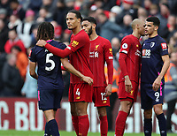 7th March 2020; Anfield, Liverpool, Merseyside, England; English Premier League Football, Liverpool versus AFC Bournemouth; Virgil van Dijk of Liverpool pats Nathan Ake of Bournemouth on the back as the match ends with a 2-1 Liverpool win