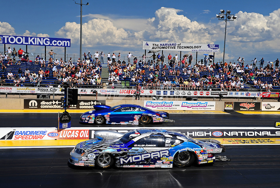 Jul. 24, 2011; Morrison, CO, USA: NHRA pro stock driver Allen Johnson (near lane) races alongside Kurt Johnson during the Mile High Nationals at Bandimere Speedway. Mandatory Credit: Mark J. Rebilas-