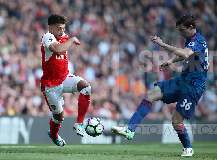 Arsenal's Alex Oxlade-Chamberlain tussles with Manchester United's Matteo Darmian during the Premier League match at the Emirates Stadium, London. Picture date: May 7th, 2017. Pic credit should read: David Klein/Sportimage