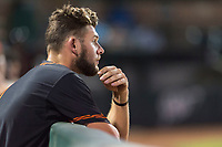 AZL Giants Black first baseman Zander Clarke (9) in the dugout during an Arizona League game against the AZL Rangers at Scottsdale Stadium on August 4, 2018 in Scottsdale, Arizona. The AZL Giants Black defeated the AZL Rangers by a score of 6-3 in the second game of a doubleheader. (Zachary Lucy/Four Seam Images)