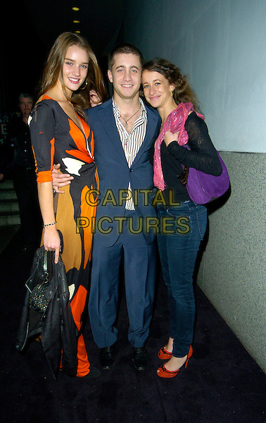 ROSIE HUNTINGTON-WHITELY, TYRON WOOD & LEAH WOOD.Attends the Matthew Williamson - 10 Years in Fashion - Gala at the Design Museum in London, England, .October 16 2007..full length Huntington -Whiteley orange black print maxi dress red shoes purple bag family.CAP/CAN.©Can Nguyen/Capital Pictures