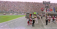 Pit crewmen hold their signboards to show the drivers where to pit on the pace lap before the Pepsi 400 at Daytona International Speedway, Daytona Beach, FL, July 7, 1990 (Photo by Brian Cleary/www.bcpix.com)