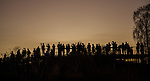 Uluru, Australia sunrise lookout and base trail hike. Visitors gather at one of the overlooks to await sunrise over Uluru.  Photo/Victoria Sheridan 2015.
