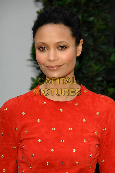 THANDIE NEWTON.F1 Party hosted by the Great Ormond Street Hospital Children's Charity, at The Worx..4th July 2007 London, UK.half length red gold studs studded .CAP/PL.©Phil Loftus/Capital Pictures