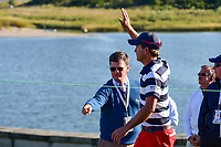 Kevin Kisner (USA) departs 14 and waves to President Trump watching from high above in the Clubhouse during round 4 Singles of the 2017 President's Cup, Liberty National Golf Club, Jersey City, New Jersey, USA. 10/1/2017. <br /> Picture: Golffile | Ken Murray<br /> <br /> All photo usage must carry mandatory copyright credit (&copy; Golffile | Ken Murray)