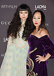 LOS ANGELES, CA - NOVEMBER 04: Asia Chow (L) and Co-host Eva Chow attend the 2017 LACMA Art + Film Gala Honoring Mark Bradford and George Lucas presented by Gucci at LACMA on November 4, 2017 in Los Angeles, California.