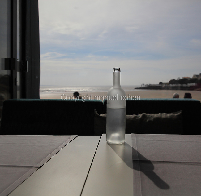 Bottle of water in a beachside restaurant in the bay of Pontaillac, Royan, Poitou-Charentes, France. Picture by Manuel Cohen
