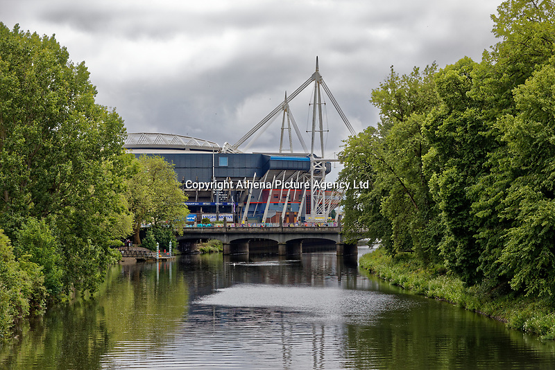 River Taff in Bute Park with the Principality Stadium see in the distance, Cardiff, Wales, UK. Wednesday 12 June 2019