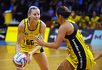 Katrina Grant passes to Liana Leota during the ANZ Netball Championship match between the Central Pulse and NSW Swifts at TSB Bank Arena, Wellington, New Zealand on Saturday, 25 April 2015. Photo: Dave Lintott / lintottphoto.co.nz