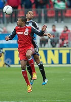 24 March 2012: Toronto FC foward/midfielder Ryan Johnson #9 and San Jose Earthquakes midfielder Brad Ring #5 in action during the first half in a game between the San Jose Earthquakes and Toronto FC at BMO Field in Toronto..