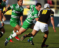 Manawatu first five Aaron Cruden takes on Dan Kirkpatrick during the Air NZ Cup preseason match between Manawatu Turbos and Wellington Lions at FMG Stadium, Palmerston North, New Zealand on Friday, 17 July 2009. Photo: Dave Lintott / lintottphoto.co.nz