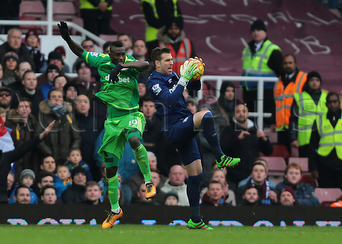27.02.2016. Boleyn Ground, London, England. Barclays Premier League. West Ham versus Sunderland. West Ham United Goalkeeper Adrian gathers the ball as Sunderland Forward Dame N'Doye adds pressure