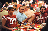 NWA Democrat-Gazette/ANDY SHUPE<br /> Kyle Blevins (center) of Bentonville shares a laugh Friday, with Jack Kraus, a former Bentonville and current Arkansas tight end, and Jackson Hannah, a former Bentonville and current Arkansas offensive lineman, Aug. 18, 2017, during the Kickoff Luncheon at the Northwest Arkansas Convention Center in Springdale. Visit nwadg.com/photos to see more photographs from the luncheon.