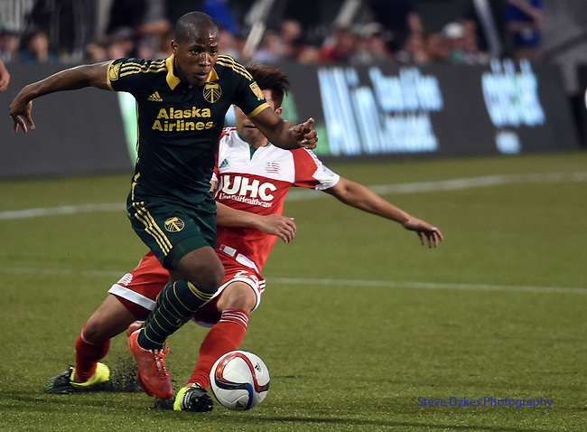 Jun 6, 2015; Portland, OR, USA; Portland Timbers forward/midfielder Darlington Nagbe (6) tries to get by New England Revolution midfielder/forward Lee Nguyen (24) during the second half of the game at Providence Park. The Timbers won the game 2-0. Mandatory Credit: Steve Dykes-USA TODAY Sports