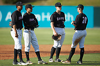 (L-R) Johan Cruz (5), Laz Rivera (13), Anthony Villa (37), and Tate Blackman (20) chat while a pitching change is made in the game against the Hagerstown Suns at Kannapolis Intimidators Stadium on May 6, 2018 in Kannapolis, North Carolina. The Intimidators defeated the Suns 4-3. (Brian Westerholt/Four Seam Images)