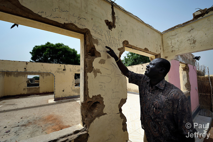 Kuol Deng Kuol, the paramount chief of the Dinka Ngok, looks at racist graffiti written on the walls of looted government offices in Abyei, a town at the center of the contested Abyei region along the border between Sudan and South Sudan. The town was looted and burned in 2011 when mostly Arab soldiers and militias from the northern Republic of Sudan swept through the area, chasing out more than 100,000 Dinka Ngok residents. The chief and a few thousand other families returned once northern combatants withdrew in 2012. On May 4, 2013, the chief was killed when his vehicle, part of a United Nations convoy, was fired upon by Khartoum-backed Misseriya militia.