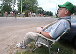 Daryl Dixon of LaPorte City sits roadside in Washburn Friday morning to watch RAGBRAI XXXVIII riders pass.
