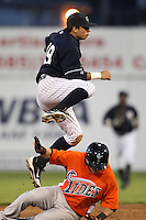 Empire State Yankees shortstop Ramiro Pena #19 turning a double play during a game against the Norfolk Tides in the first ever Triple-A contest to be held at Dwyer Stadium on April 20, 2012 in Batavia, New York.  (Mike Janes/Four Seam Images)