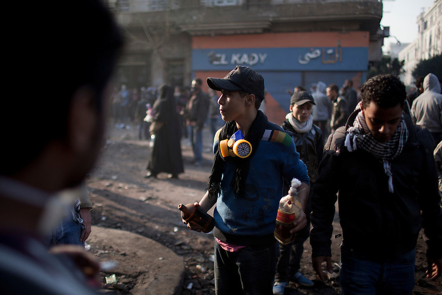 An Egyptian protester holds two molotov cocktails during clashes near Cairo's Tahrir Square, Egypt, November 22, 2011. Photo: Ed Giles.