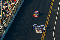 Trevor Bayne (#21) races to the checkered flag as Carl Edwards (#99) makes a final try as David Gulliland (#34) and Bobby Labonte (#47) follow.