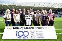 Todays match shirt sponsors with Lee Trundle and Leon Britton prior to the Sky Bet Championship match between Swansea City and Bristol City at the Liberty Stadium, Swansea, Wales, UK. Saturday 25 August 2018
