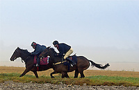 Young men racing their horses, Berkshire, United Kingdom