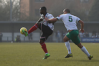 Jon-Paul Pittman of Grimsby Town is challenged by Sami El-Abd of Bognor Regis Town during the FA Trophy Semi Final first leg match between Bognor Regis and Grimsby Town at Nyewood Lane, Bognor Regis, England on 12 March 2016. Photo by Paul Paxford/PRiME Media Images.