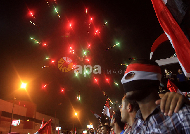 Opponents of Egyptian President Mohammed Mursi celebrate as they gather in Cairo July 3, 2013. The head of Egypt's armed forces General Abdel Fattah al-Sisi issued a declaration on Wednesday suspending the constitution and appointing the head of the constitutional court as interim head of state, effectively declared the removal of elected Islamist President Mohamed Mursi. Photo by Ahmed Asad