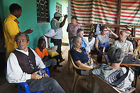 "Ethiopia. Southern Nations, Nationalities, and Peoples' Region. Omo Valley. Turmi. Market day. Marc Vella (seated on the blue chair on the left) is a french musician and a nomadic pianist. Over the last 25 years he has travelled with his Grand Piano in around forty countries to celebrate humanity. Thanks to the variacordes which he has devised, his piano music is unique. Creator of ""La Caravane amoureuse"" (The Caravan of Love) he takes people with him to say ""I love you"" to others and ""lovingly conquered"" their hearts and souls. Coca Cola, minearl water, coffee and tea break in a public bar. The Omo Valley, situated in Africa's Great Rift Valley, is home to an estimated 200,000 indigenous peoples who have lived there for millennia. Amongst them are 60'000 to 70'000 Hamar, an Omotic community inhabiting southwestern Ethiopia. Southern Nations, Nationalities, and Peoples' Region (often abbreviated as SNNPR) is one of the nine ethnic divisions of Ethiopia. 9.11.15 © 2015 Didier Ruef"