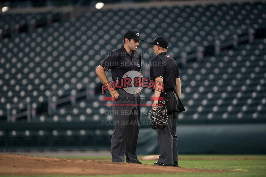 Umpires Alan Gorewitz and Austin Nelson discuss a play during an Arizona League game between the AZL Rangers and the AZL Cubs 2 at Sloan Park on July 7, 2018 in Mesa, Arizona. AZL Rangers defeated AZL Cubs 2 11-2. (Zachary Lucy/Four Seam Images)